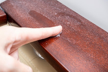 A Finger Swiping Dust From Furniture, Dusty Home Concept