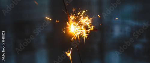Sparklers for Christmas and New Year close-up in the form of a banner and on a b Fototapet