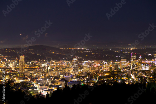 Portland Oregon city skyline at night and powerful lights illuminating highrise office buildings Canvas Print