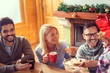 canvas print picture - Friends eating gingerbread Christmas cookies on Christmas morning