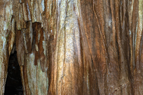 Cave wall makes a nice abstract image, background or texture. Copy space available. Bokeh effect.