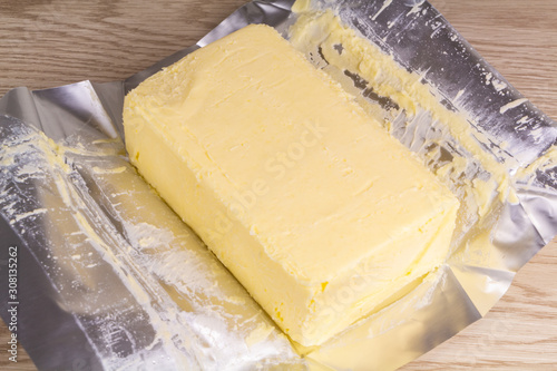 Valokuva Pack of salted butter with unwrapped paper