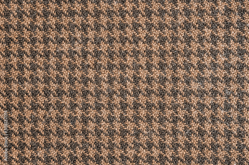 Photo Seamless brown and black generic houndstooth fabric pattern background texture