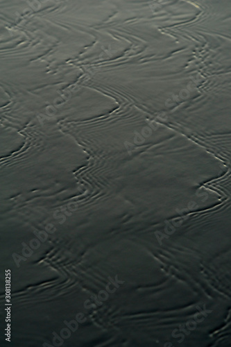 Photo Water flowing over black sand on a beach at Papagayo Bay