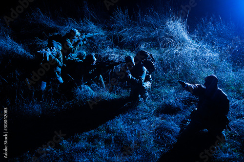 Army tactical group fighters sneaking in darkness Canvas Print