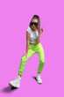 Leinwandbild Motiv Girl in a white T-shirt and yellow neon sweatpants on a colored background