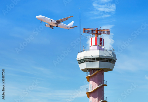 Radar  air traffic control tower in international airport while airplane taking off under blue sky Tableau sur Toile