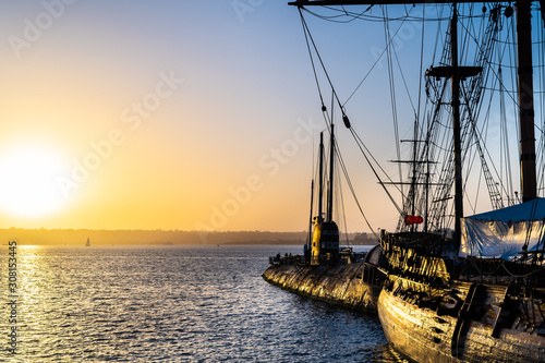 Canvas Prints Ship HMS Surprise ship, a tall modern replica of HMS Rose docked at Maritime Museum on the waterfront harbor bay in San Diego, Southern California at sunset.