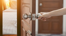Women Hand Open Door Knob Or O...