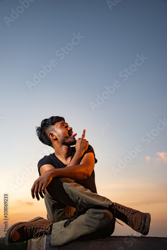 man who do not care anything and show middle finger in beautiful sky Wallpaper Mural