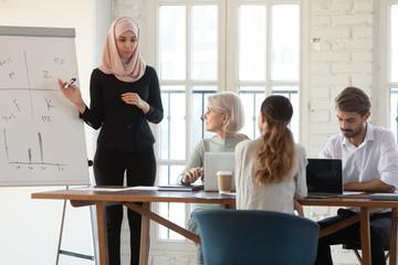 Focused arabian businesswoman coach holding workshop training.