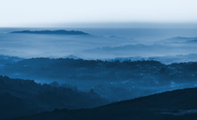 Layers Of Foggy Mountains Blue...