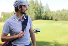 Portrait Of Male Golfer Carryi...
