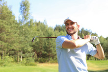 Golfer Hits An Fairway Shot Towards The Club House.