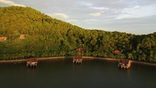 A Drone-shot Of Wooden Huts Standing On Water. It Was Filmed During A Beautiful Sunrise In Vietnam With A Mavic II Pro Drone.