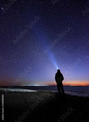 Fototapeta Lonely man at the beach under the stary sky obraz