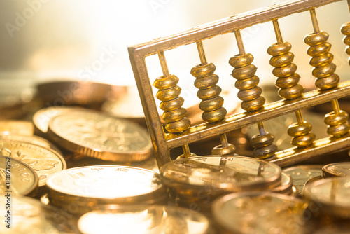 Photo A gold abacus was placed on the background of the pile of COINS