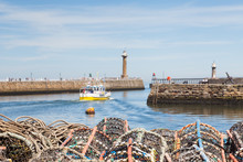Whitby Lobster Pots.  The View Across Lobster Fishing Pots Stacked On The Keyside Of The Seaside Town Of Whitby In Yorkshire, Northern England.