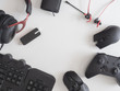 gamer work space concept, top view a gaming gear, mouse, keyboard, joystick and headset on white table background.