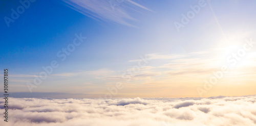 Aerial view White clouds in blue sky. Top view. View from drone. Aerial bird's eye view. Aerial top view cloudscape. Texture of clouds. View from above. Sunrise or sunset over clouds - 308197885