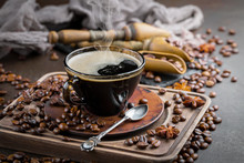 Black Coffee On An Old Background In A Cup