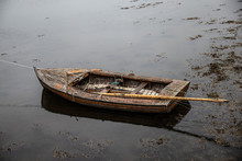 Row Boat At Low Tide