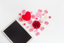 Valentine's Frame Composition Background, Pink Chocolate, Candy, Red Heart And Ribbon Decorated With Black Chalkboard On White Wooden Table Texture, Copy Space For Card, Banner Design, Flat Lay