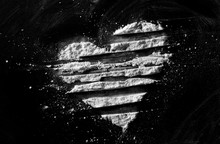 White Powder In Shape Heart, Cocaine Line Isolated On Black Background, Top View, Series