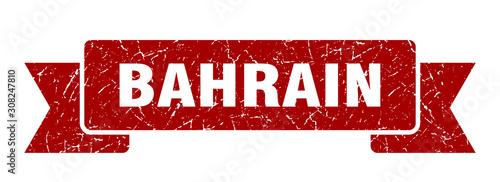 Photo Bahrain ribbon. Red Bahrain grunge band sign