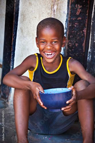 Obraz African child in a village - fototapety do salonu