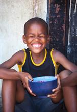 African Child In A Village