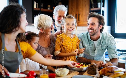 obraz dibond Portrait of happy family in kitchen at home