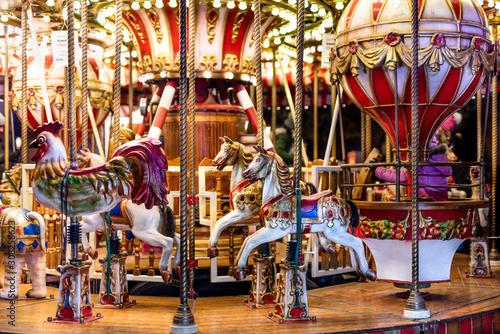 Obraz na plátně Christmas colorful carousel with lights