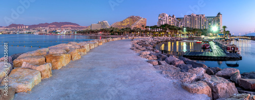 Cuadros en Lienzo Night panoramic view from public walking pier on central beach and promenade of