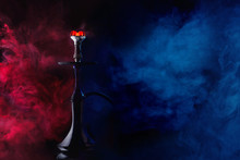 A Glossy Hookah With Burning C...