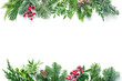canvas print picture Flat lay composition with winter fir branches, cones, holly isolated on white background
