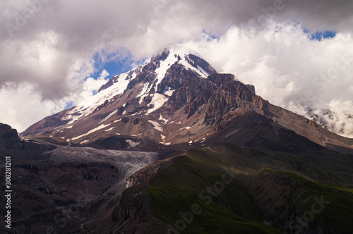 Fototapety, obrazy:  Kazbek. Peak. The highest point of Georgia. High mountain against the sky with clouds.