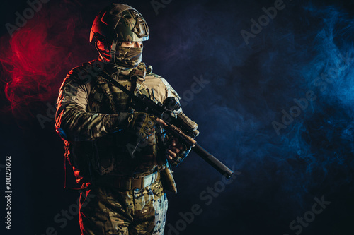 courageous soldier man in green military wear holding gun, rifle in hands, don't Canvas Print