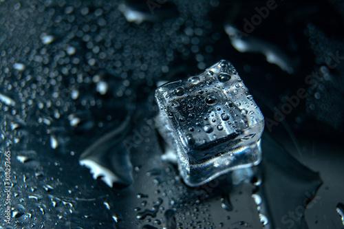Close up Cubes of ice on black background / melting ice cube