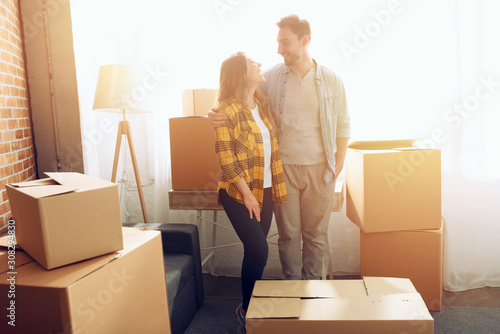 Happy couple have to move and arrange all the packages Canvas Print