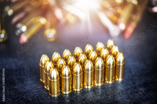 9mm rounds or bullets ammonution on dark stone table Wallpaper Mural