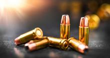 Bullets Ammunition On Stone Ta...