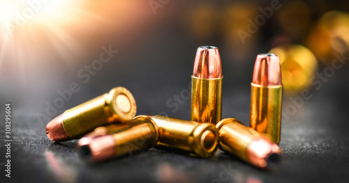 Fotografía Bullets ammunition on stone table wide banner or panorama