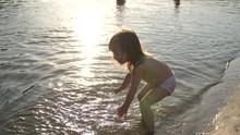 Baby Splashing In The Water. S...