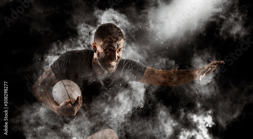 Fotografía Handsome rugby player in action