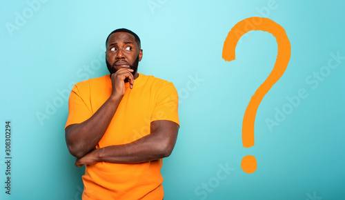 Confuse and pensive expression of a boy with a big question Wallpaper Mural