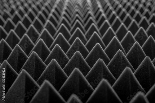 Photo Abstract background in the form of pyramids and dragon scales