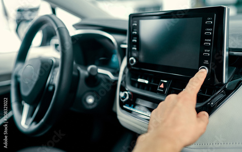 Cuadros en Lienzo Transportation and vehicle concept - man using car audio stereo system