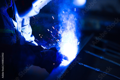 technician working with electric arc welding Wallpaper Mural