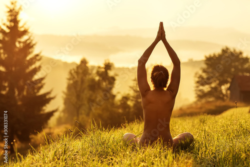 Stampa su Tela  Woman practices yoga